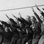 A group of women give the Nazi salute on the deck of the Wilhelm Gustloff at Tilbury, 10th April 1938. The ship is a floating polling station enabling the 2,500 German citizens resident in Britain to vote in Nazi Germany's 1938 plebiscite.  (Photo by Becker/Fox Photos/Hulton Archive/Getty Images)