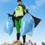 27125205 - eco superhero holding two plastic bags full of domestic trash standing on garbage heap - waste segregation concept